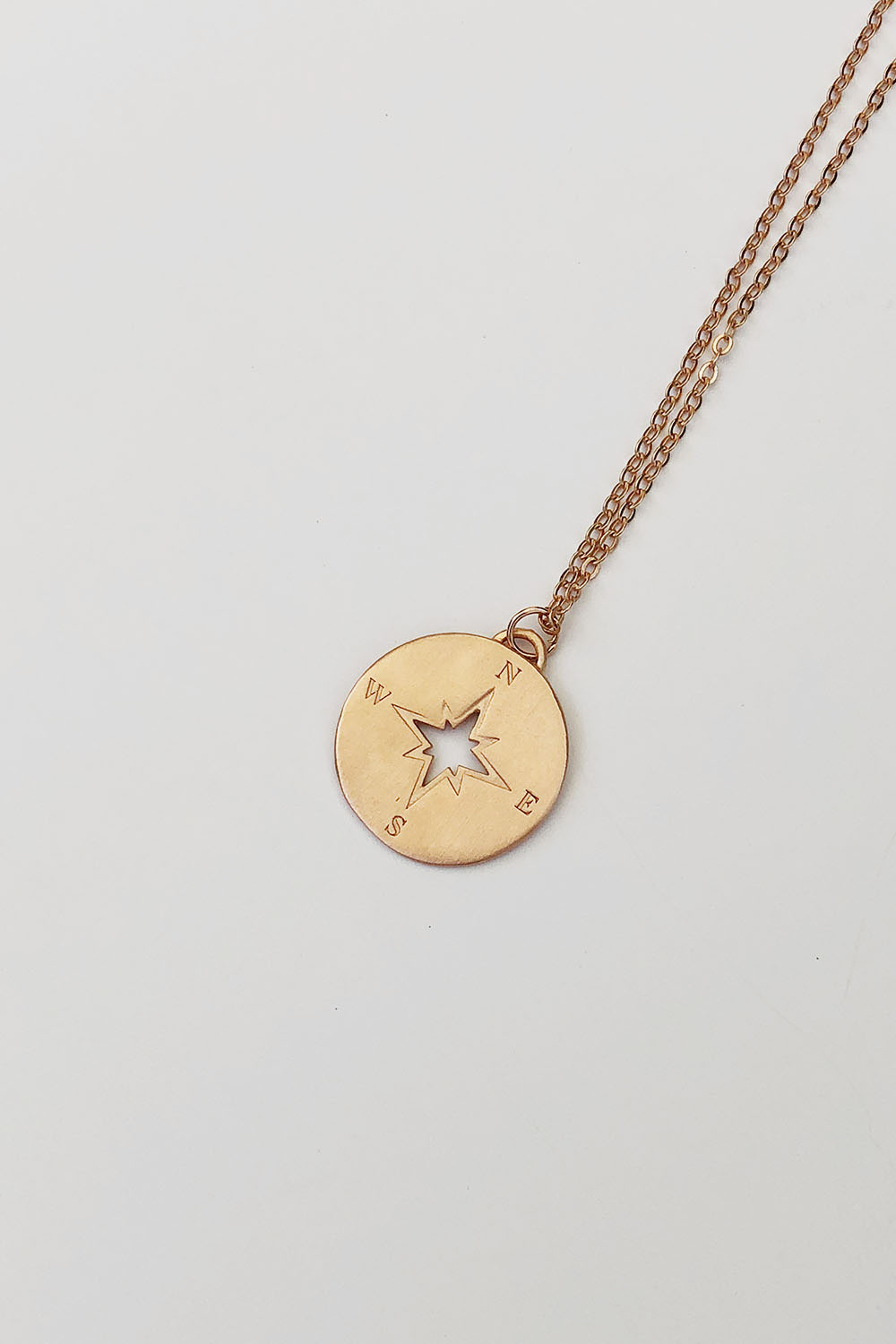 Compass necklace in rose gold