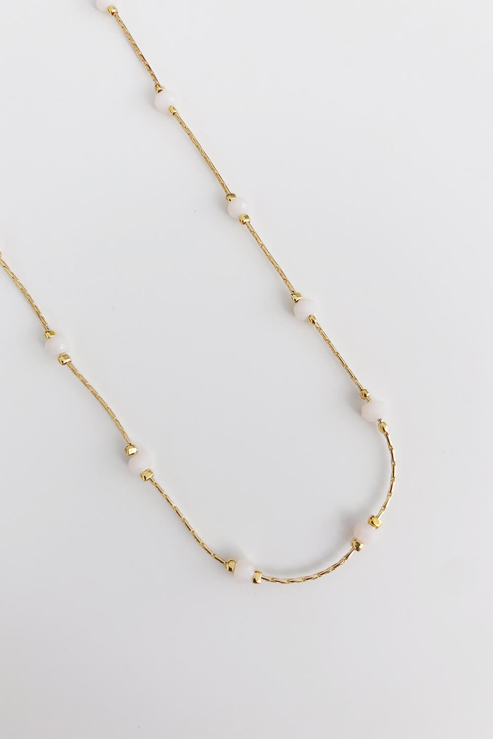 Long white & gold plated necklace