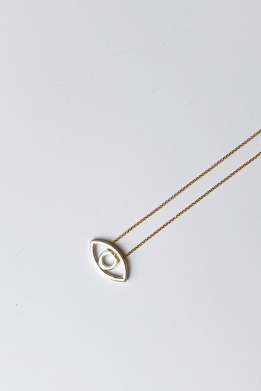 Gold and silver plated eye necklace